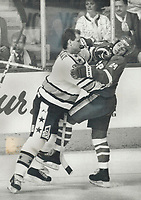 1987 FILE PHOTO - ARCHIVES -<br /> <br /> Take that: NHL all-star defenceman Rod Langway of the Washington Capitals makes Soviet forward Sergei Makarov stand up and take notice with this solid check during action at last night's exhibition game in Quebec city. Langway, as usual played a very steady game of the Team NHL blueline.<br /> <br /> PHOTO :  Jeff Goode - Toronto Star Archives - AQP