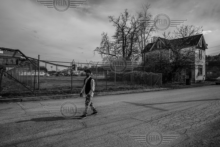 Activist Isaac Bunn walks near his family's home in Braddock. His house is the only one left on the block near the Edgar Thomson steel mill. <br /><br />The population of Pittsburgh, the urban area that Braddock is a part of, has halved since its 1960s high point. Like many of the so-called rust belt states, Pennsylvania's heavy industries have declined due to globalisation, automation and a move away from polluting industries. The resulting de-industrialisation has led to rising unemployment or wage stagnation, falling urban populations and rising inequality.