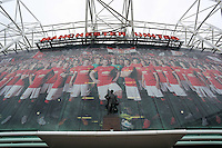 Pictured: The statue of Sir Matt Busby infront of a banner with a line-up of Manchester United players outside the Old Trafford. Saturday 16 August 2014<br />