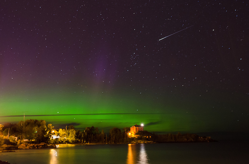 A view of the Northern Lights over the Marquette Harbor Lighthouse on Lake Superior. An Iridium Flare satellite can also be seen in the capture. Marquette, MI