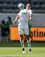 LOS ANGELES, CA - APRIL 17: Matt Besler #5 of Austin FC with a nice trap during a game between Austin FC and Los Angeles FC at Banc of California Stadium on April 17, 2021 in Los Angeles, California.