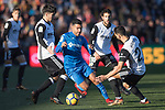 Angel Luis Rodriguez Diaz of Getafe CF fights for the ball against Carlos Soler Barragan of Valencia CF, Daniel Parejo Munoz of Valencia CF, and Martin Montoya Torralbo of Valencia CF during the La Liga 2017-18 match between Getafe CF and Valencia CF at Coliseum Alfonso Perez on December 3 2017 in Getafe, Spain. Photo by Diego Gonzalez / Power Sport Images