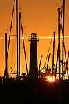 The lighthouse and marina at sunset at Shoreline Village and Rainbow Harbor, Long Beach, CA