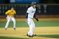 Stuart Fairchild (4) of the Wake Forest Demon Deacons takes his lead off of third base against the Kent State Golden Flashes in game two of a double-header at David F. Couch Ballpark on March 4, 2017 in  Winston-Salem, North Carolina.  The Demon Deacons defeated the Golden Flashes 5-0.  (Brian Westerholt/Four Seam Images)