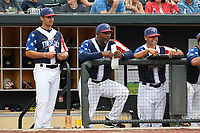 Coaches for the Columbia Fireflies in a game against the Rome Braves on Monday, July 3, 2017, at Spirit Communications Park in Columbia, South Carolina. From left: manager Jose Leger, pitching coach Jonathan Hurst and hitting coach Joel Fuentes. Columbia won, 3-2. (Tom Priddy/Four Seam Images)