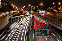 Trails of car lights as seen at night from the Ward Avenue overpass in Honolulu, O'ahu.