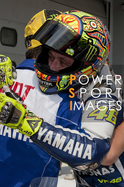 KUALA LUMPUR, MALAYSIA - OCTOBER 24:  Valentino Rossi of Italy celebrates with team member after tooking pole position after qualifying for the Malaysian MotoGP, which is round 16 of the MotoGP World Championship at the Sepang Circuit on October 24, 2009 in Kuala Lumpur, Malaysia. Photo by Victor Fraile / The Power of Sport Images