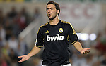SANTANDER - SEPTEMBER 21:  Gonzalo Higuain of Real Madrid reacts to the referee during the La Liga soccer match between Real Racing Club and Real Madrid at El Sardinero Stadium on September 21, 2011 in Santander, Spain. Photo by Victor Fraile / The Power of Sport Images