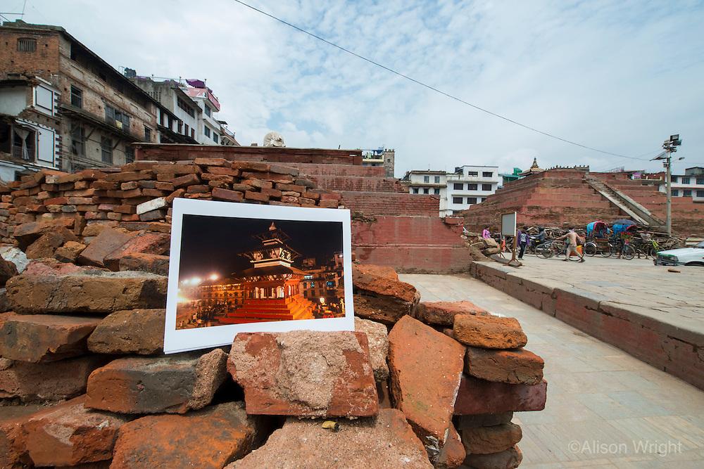 Nepal, Kathmandu, earthquake damage at Kathmandu Durbar Square. Photos of how the temples looked previously.