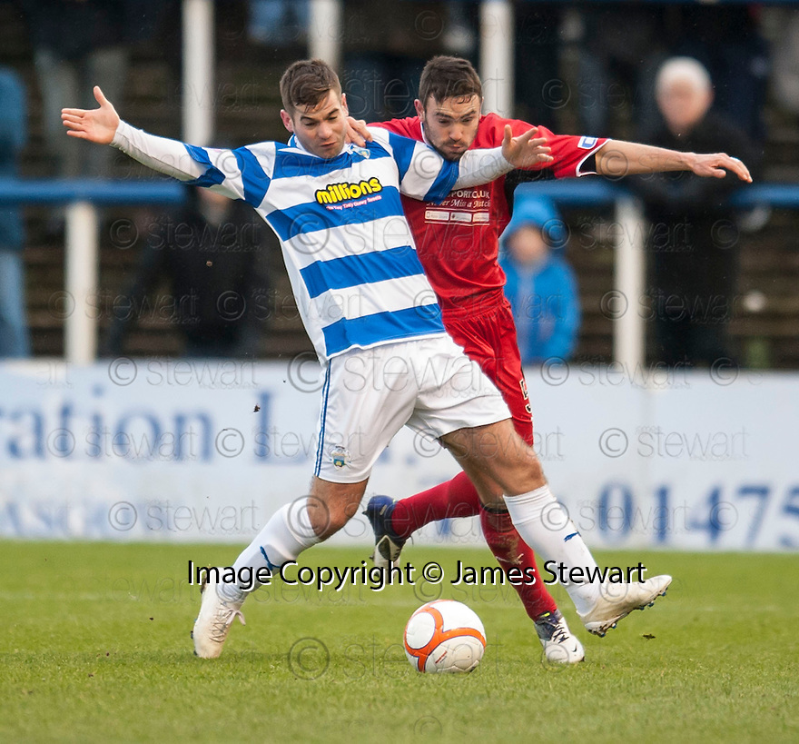 Morton's Peter MacDonald and Raith's Laurie Ellis challenge for the ball.