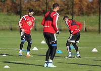Pictured L-R: Jordi Amat (L) and Angel Rangel Wednesday 05 November 2014<br /> Re: Swansea City FC players training at Fairwood training ground, ahead of their Premier League game against Arsenal on Sunday.