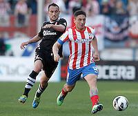 Atletico de Madrid's Cristian Cebolla Rodriguez (r) and Granada's Juanma Ortiz during La Liga match.April 14,2013. (ALTERPHOTOS/Acero)