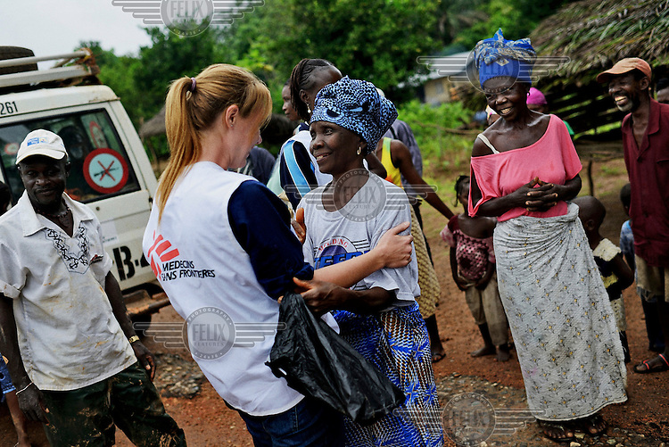 Abnach Bayu hugs Elle Watson, a Medecins sans Frontieres (MSF) medical worker, after the MSF team arrives in her village. Abnachh Bayu survived being infected with Ebola due to treatment she received at the MSF center in Kailahun. The government of Sierra Leone declared a state of emergency on 30 July and deployed troops to quarantine the hot spots of the epidemic. <br /> <br /> Sierra Leone is one of three countries severely affected by the Ebola outbreak in West Africa which started in Guinea in December 2013 and spread to neighbouring countries including Liberia, Senegal and Nigeria. By late September 2014 it had killed close to 3,000 people across the region, 554 in Sierra Leone alone, making it the worst outbreak of the disease since it was identified in 1976. It is believed that the reported number of cases and deaths may well exceed the official figures due to an unwillingness to report cases among the population and a lack of resources to properly investigate suspected cases. Ebola virus disease (EVD) is a disease which affected humans and other primates and is transmitted by coming in contact with blood or other bodily fluids from infected persons or animals. It is believed that the disease is carried by fruit bats which can spread the virus without being affected themselves. In parts of West Africa, the consumption of so-called 'bushmeat' is thought to have caused the most recent outbreak.