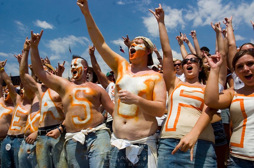 02 September 2006: Members of the University of Texas Hellraiser and Hellraiser Honey spirit groups cheer on their alma mater during the Longhorns 56-7 victory over the University of North Texas at Darrell K Royal Stadium in Austin, TX.
