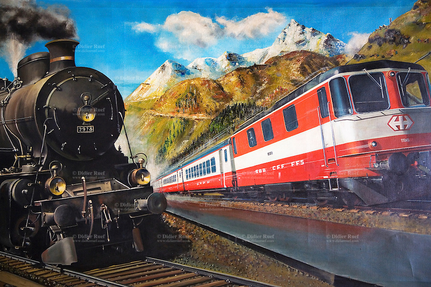 Switzerland. Canton Ticino. Airolo.  Painting on the wall of the railway's restaurant. New electric and old steam locomotives. SBB CCF FFS train at the Gotthard railway tunnel. Traffic by rail. Leventina valley. Clock. 01.04.08  © 2008 Didier Ruef ...