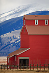 Red barn and snowy mountains near Ovando, Montana