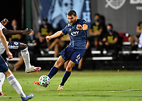 LAKE BUENA VISTA, FL - JULY 26: Ilie Sánchez of Sporting KC takes a shot during a game between Vancouver Whitecaps and Sporting Kansas City at ESPN Wide World of Sports on July 26, 2020 in Lake Buena Vista, Florida.