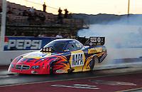 Jan 25, 2009; Chandler, AZ, USA; NHRA funny car driver Ron Capps does a burnout during testing at the National Time Trials at Firebird International Raceway. Mandatory Credit: Mark J. Rebilas-