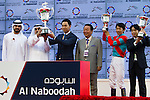 DUBAI,UNITED ARAB EMIRATES-MARCH 26: Mikio Matsunaga (left,trainer),Yutaka Take (second from left,jockey) and Koji Maeda (third from left) attend the UAE Derby winning ceremony at Meydan Racecourse on March 26,2016 in Dubai,UAE (Photo by Kaz Ishida)
