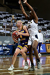 SIOUX FALLS, SD - MARCH 7: Danni Nichols #4 of the Western Illinois Leathernecks eyes the basket against Jada Mickens #32 of the UMKC Kangaroos during the Summit League Basketball Tournament at the Sanford Pentagon in Sioux Falls, SD. (Photo by Dave Eggen/Inertia)