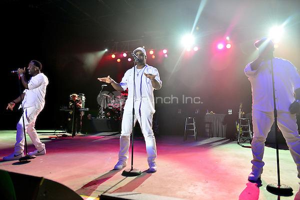 POMPANO BEACH, FL - DECEMBER 02: Shawn Stockman, Nathan Morris and Wanya Morris of Boyz II Men perform onstage at Pompano Beach Amphitheatre on December 2, 2016 in Pompano Beach, Florida. Credit: MPI10 / MediaPunch