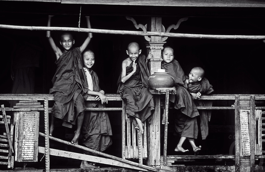 Novice Buddhist Monks messing around at a Monastery in Yangon in 1992. Interesting to note that this Monastery was located right next to a Garbage Dump.