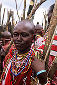 Lolgorian, Kenya. Female Siria Maasai with colourful bead necklaces helping to build the Magic House at the Eunoto ceremony.