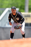 Omaha Storm Chasers third baseman Christian Colon (4) during a game against the Nashville Sounds on May 20, 2014 at Herschel Greer Stadium in Nashville, Tennessee.  Omaha defeated Nashville 4-1.  (Mike Janes/Four Seam Images)