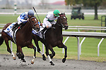 House of Grace with Michael Luzzi (blue cap) out duels Smart Strike with Jeremy Rose (green cap) to win The JP Morgan Jessamine Stakes at Keeneland. 10.15.2009