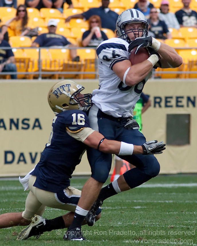 New Hampshire tight end Chris Jeannot gets tackled by Pitt defensive back Kolby Gray (16) after making a catch. The Pittsburgh Panthers defeat the New Hampshire Wildcats 38-16 at Heinz Field, Pittsburgh Pennsylvania on September 11, 2010.