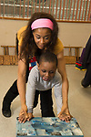 Education Preschool 3-4 year olds SEIT therapist working with boy during preschool day