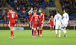 UEFA European Championship at Cardiff City Stadium - Wales v Cyprus : <br /> Andy King of Wales is sent off with a red card as Joe Ledley argues with the referee Manuel Grafe of Germany.