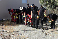 """Pictured: Special forensics police officers search a field in Kos, Greece. Monday 26 September 2016<br /> Re: Police teams searching for missing toddler Ben Needham on the Greek island of Kos have said they are """"optimistic"""" about new excavation work.<br /> Ben, from Sheffield, was 21 months old when he disappeared on 24 July 1991 during a family holiday.<br /> Digging has begun at a new site after a fresh line of inquiry suggested he could have been crushed by a digger.<br /> South Yorkshire Police (SYP) said it continued to keep an """"open mind"""" about what happened to Ben."""
