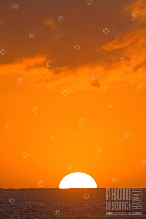 The sun sets over the horizon on O'ahu.
