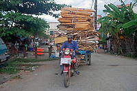 Carrying a heavy load of Cardboard for recycling Battambang, Cambodia