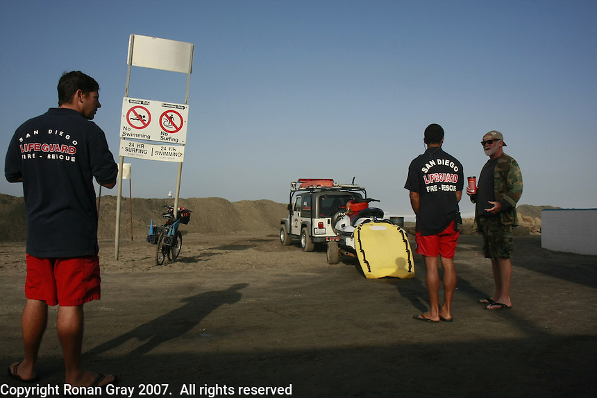 San Diego Lifeguards .Neil Collins and Mike Gilmore get ready for a busy day at Ocean Beach on Wednesday, December 5, 2007.  A large storm swell hit San Diego shores on Wednesday, December 5, 2007.