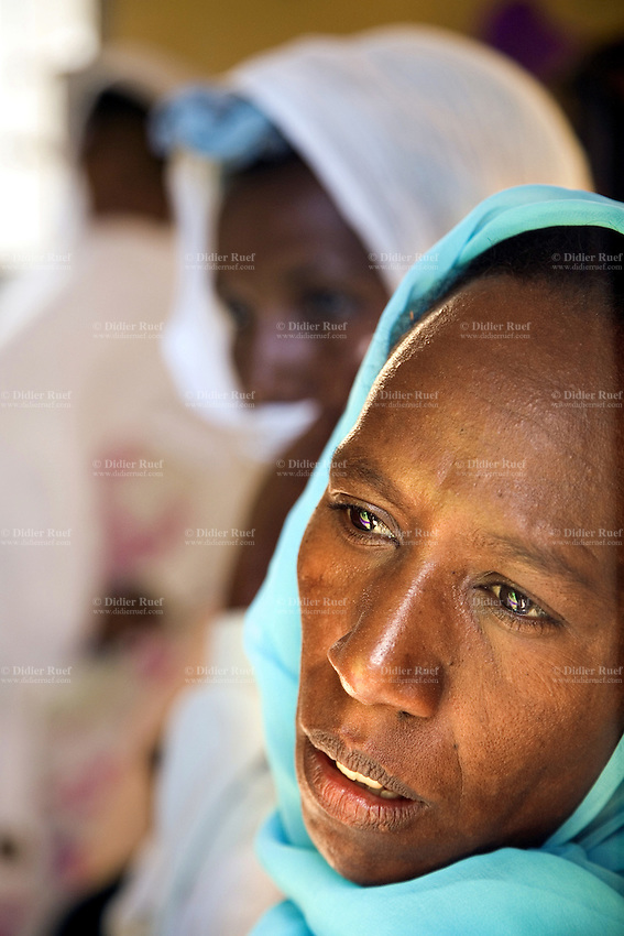 Eritrea. Maekel province. Asmara. Felge Hiwet (which means The source of life) is an integrated service center. Voluntary Councelling and Testing (VCT) and Prevention Mother to Child Transmission (PMTCT) for HIV Aids. A group of black women, covering their with colorful veils, listen to a lecture on Aids sensibilisation. The Global Fund through the eritrean Ministry of Health supports the programm with a Aids grant (financial aid).   © 2006 Didier Ruef