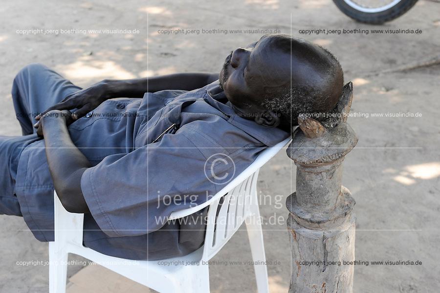 SOUTH SUDAN  Bahr al Ghazal region , Lakes State, town Cuibet, sleeping man on plastic chair / SUED-SUDAN  Bahr el Ghazal region , Lakes State, Cuibet , schlafender Mann auf Plastik Stuhl