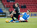 St Johnstone v Partick Thistle…27.01.18…  McDiarmid Park…  SPFL<br />Steven MacLean  brings down Martin Woods<br />Picture by Graeme Hart. <br />Copyright Perthshire Picture Agency<br />Tel: 01738 623350  Mobile: 07990 594431