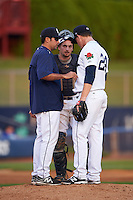 Connecticut Tigers pitching coach Carlos Chantres (26), catcher Shane Zeile (59) and pitcher Josh Heddinger (24) during the first game of a doubleheader against the Brooklyn Cyclones on September 2, 2015 at Senator Thomas J. Dodd Memorial Stadium in Norwich, Connecticut.  Brooklyn defeated Connecticut 7-1.  (Mike Janes/Four Seam Images)