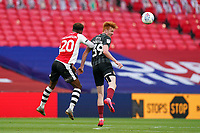 Jayden Richardson (on loan from Nottingham Forest) of Exeter City and Callum Morton (on loan from WBA) of Northampton Town in an aerial battle during the Sky Bet League 2 PLAY-OFF Final match between Exeter City and Northampton Town at Wembley Stadium, London, England on 29 June 2020. Photo by Andy Rowland.