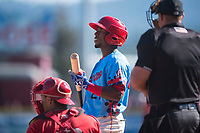 Spokane Indians center fielder Julio Pablo Martinez (27) at bat in front of home plate umpire Bryan Van Vranken and catcher Yorman Rodriguez (13) during a Northwest League game against the Vancouver Canadians at Avista Stadium on September 2, 2018 in Spokane, Washington. The Spokane Indians defeated the Vancouver Canadians by a score of 3-1. (Zachary Lucy/Four Seam Images)