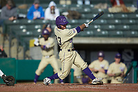 Seth Graves (33) of the Western Carolina Catamounts follows through on his swing against the Saint Joseph's Hawks at TicketReturn.com Field at Pelicans Ballpark on February 23, 2020 in Myrtle Beach, South Carolina. The Hawks defeated the Catamounts 9-2. (Brian Westerholt/Four Seam Images)