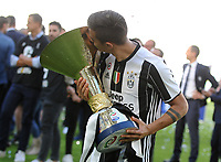 Calcio, Serie A: Juventus vs Crotone. Torino, Juventus Stadium, 21 maggio 2017.<br /> Juventus' Paulo Dybala kisses the trophy during the celebrations for the victory of the sixth consecutive Scudetto at the end of the Italian Serie A football match between Juventus and Crotone at Turin's Juventus Stadium, 21 May 2017. Juventus defeated Crotone 3-0.<br /> UPDATE IMAGES PRESS/Manuela Viganti