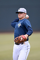 First baseman Brian Sharp (7) of the Columbia Fireflies warms up before a game against the Charleston RiverDogs on Friday, April 5, 2019, at Segra Park in Columbia, South Carolina. Charleston won, 6-1. (Tom Priddy/Four Seam Images)