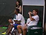 March 23 2016: Stanislas Wawrinka (SUI) takes a break with practice partner Gael Monfils (FRA) (in blue shorts) at the Miami Open being played at Crandon Park Tennis Center in Miami, Key Biscayne, Florida.