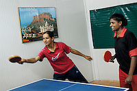LIBERIA, Monrovia, 04/04/2007..Tanu and JC Mary play table tennis in the messhall...© Aubrey Wade. All rights reserved.