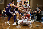 SIOUX FALLS, SD - MARCH 6: Tasos Kamateros #34 of the South Dakota Coyotes looks for help while controlling the ball against the Western Illinois Leathernecks during the Summit League Basketball Tournament at the Sanford Pentagon in Sioux Falls, SD. (Photo by Dave Eggen/Inertia)