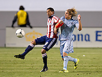 CARSON, CA - April 1, 2012: Oswaldo Minda (8) of Chivas and Chance Myers (7) of KC during the Chivas USA vs Sporting KC match at the Home Depot Center in Carson, California. Final score Sporting KC 1, Chivas USA 0.