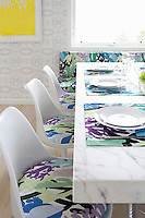 White chairs with floral pillows